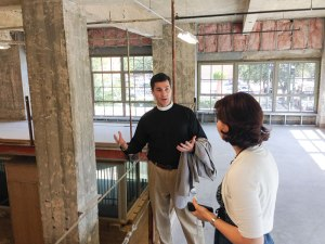 Dean Thompson and Melissa White walk through the mezzanine level on a tour of the future Hines Center space.